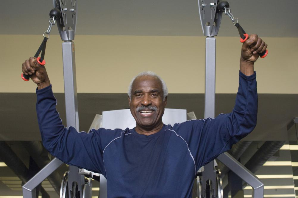 man exercising in gym